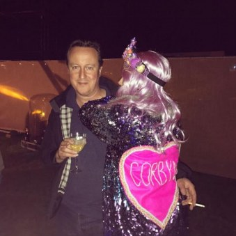 David Cameron enjoys a smoke and a cuddle